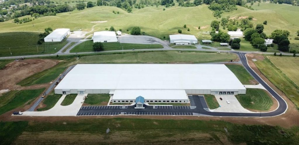 An aerial photo shows the trapezoidal standing seam roof and drive-thru entrance at Blue Ridge Knives.