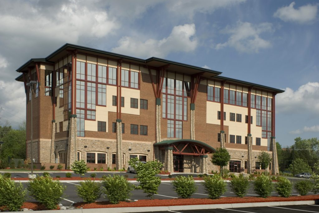 Sheridan Square, which is adorned with reflective glass, brick, cultured stone, ceramic tile and solid wood timbers.
