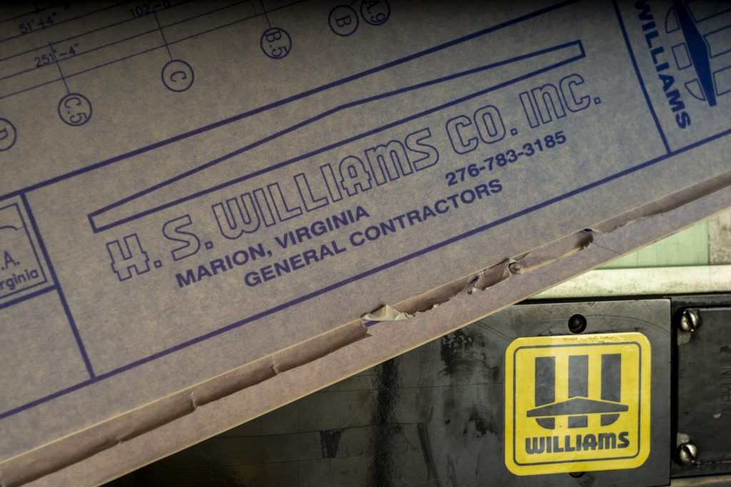 A closeup of the H.S. Williams Company logo at the bottom of construction blueprints.