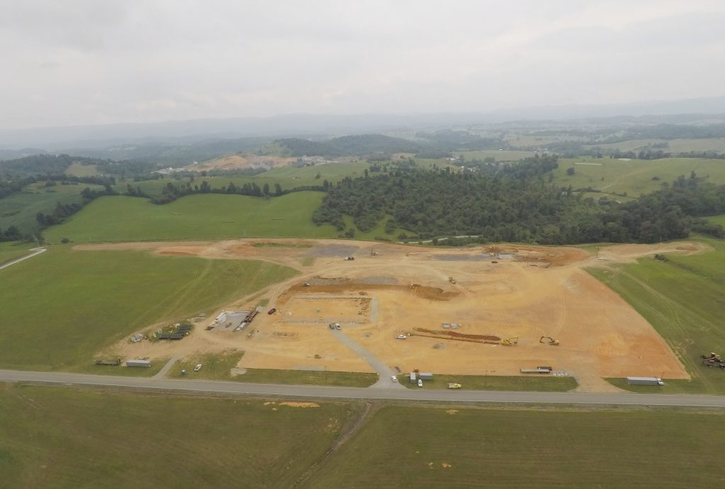 An aerial view of land being prepared for a large building to be erected.